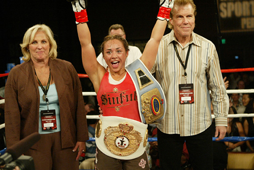 Elena Reid With Boxing Title Belts